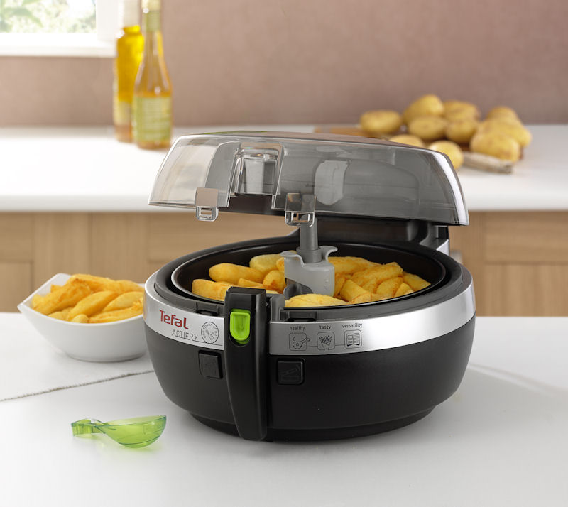 Tefal ActiFry with open lid showing golden chips